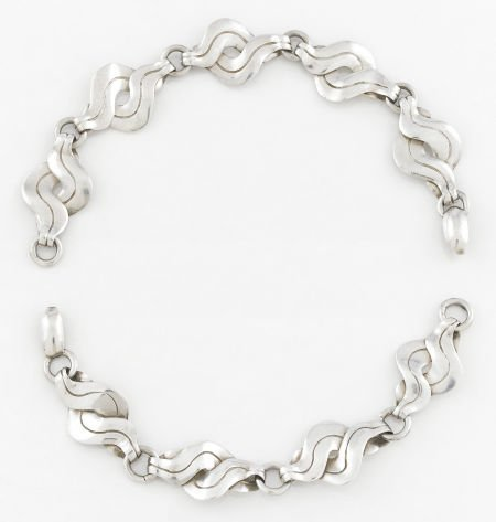 71009: A PAIR OF MEXICAN SILVER BRACELETS William Sprat