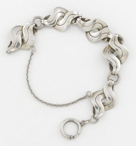 71010: A MEXICAN SILVER BRACELET William Spratling, Tax