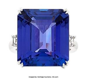 10114: Tanzanite, Diamond, White Gold Ring  The ring fe