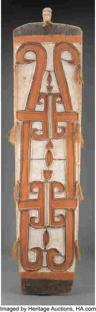 70375: An Asmat Painted Wood Shield With metal stand.
