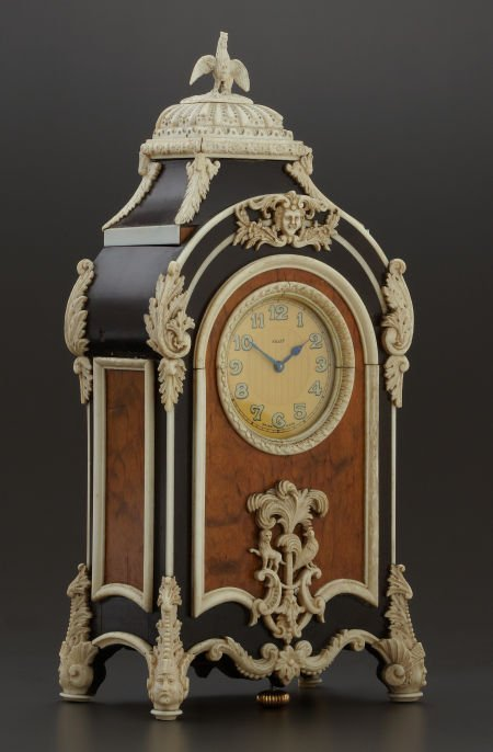 71009: AN ANGLO-INDIAN WOOD AND BONE CLOCK Maker unknow