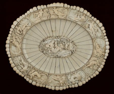 71013: A GERMAN CARVED AND APPLIED OVAL IVORY CHARGER M