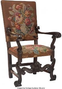 A Renaissance Revival Wood Armchair with Needlep