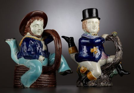 "69017: TWO VICTORIAN MAJOLICA ""THREE-LEGGED SAILOR"" TEA"