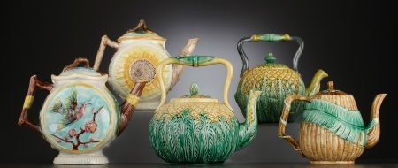 69018: A COLLECTION OF FIVE VICTORIAN MAJOLICA TEAPOTS