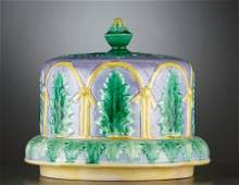 69023 A VICTORIAN MAJOLICA CHEESE STAND AND COVER  Sta