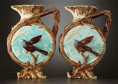69028 A PAIR OF VICTORIAN MAJOLICA RUSTIC EWERS  Staff
