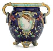 66083 A VICTORIAN MAJOLICA TWOHANDLED FOOTED JARDINI