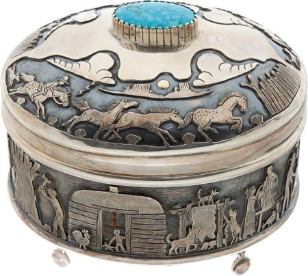 A NAVAJO SILVER, GOLD AND TURQUOISE LIDDED BOX Clarence