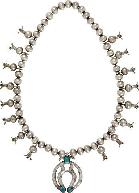 A NAVAJO SILVER AND TURQUOISE SQUASH BLOSSOM NECKLACE c