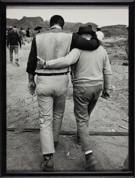46031: A John Wayne Signed Black and White Photograph t