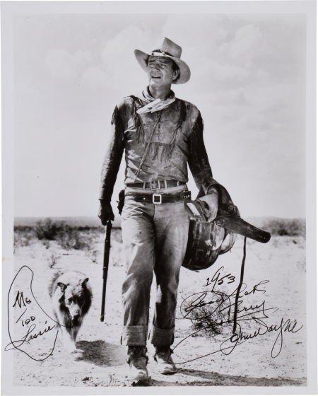 46032: A John Wayne Signed Black and White Photograph,