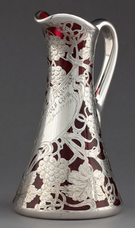 68071: AN AMERICAN GLASS PITCHER WITH SILVER OVERLAY AT