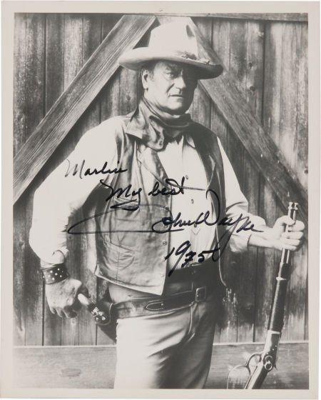 A John Wayne Signed Black and White Photograph,