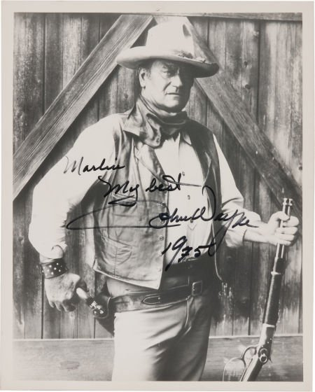 46031: A John Wayne Signed Black and White Photograph,