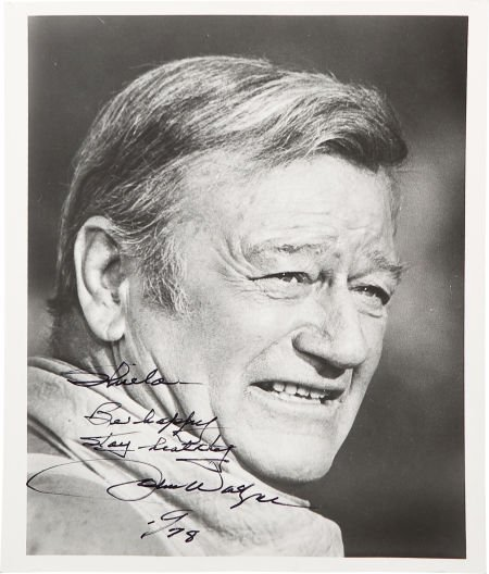 46032: A John Wayne Signed Black and White Photograph,