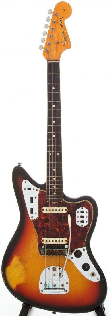 54229: 1965 Fender Jaguar Sunburst Solid Body Electric
