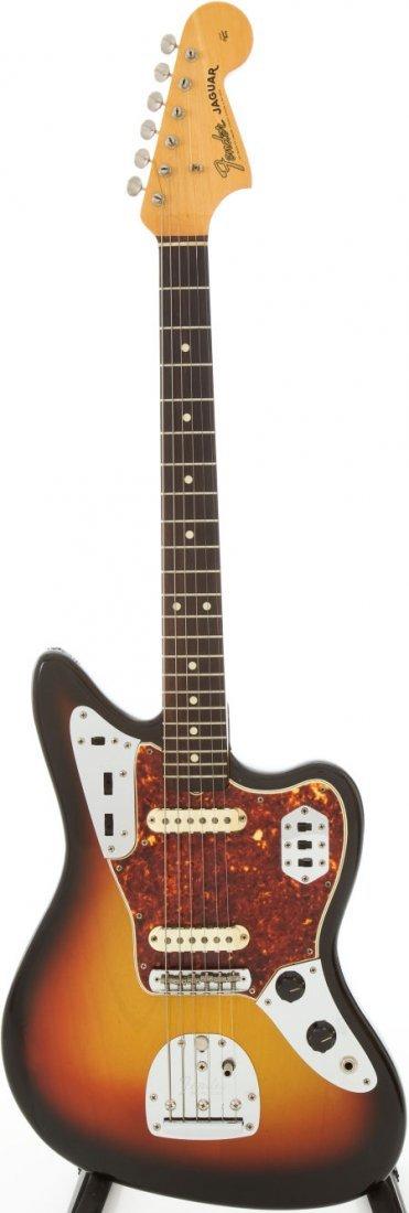 54230: 1965 Fender Jaguar Sunburst Solid Body Electric