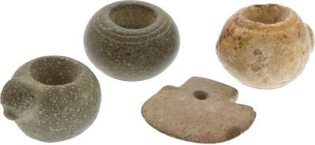 50015: Lot of Four Assorted Stone Mace Heads.