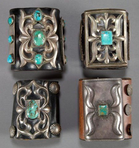 50006: FOUR NAVAJO SILVER AND TURQUOISE BOW GUARDS c. 1