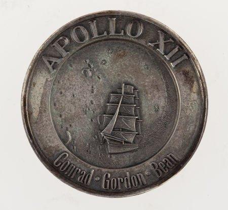 40126: Apollo 12 Flown Silver Robbins Medallion Origina