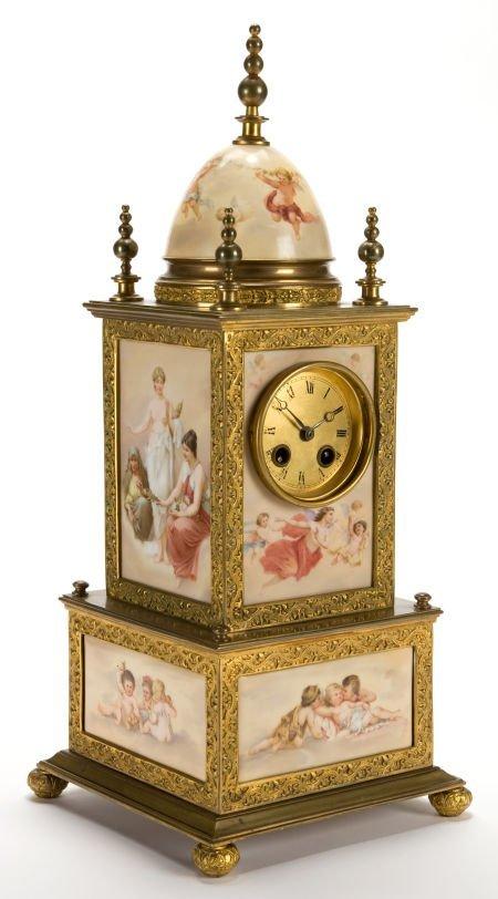 66014: AN AUSTRIAN PORCELAIN AND GILT METAL CLOCK IN TH