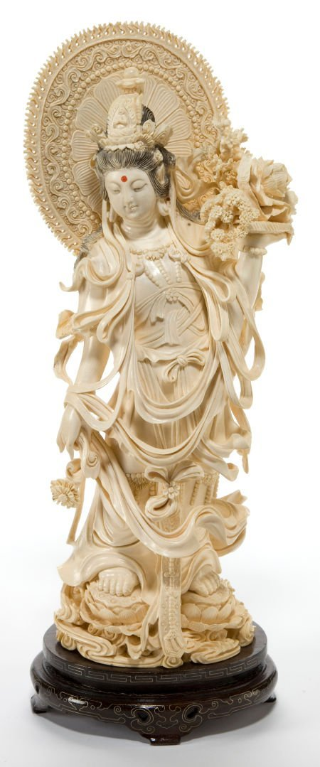 66148: A CHINESE CARVED IVORY FIGURE OF GUANYIN  Maker