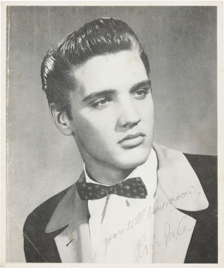 46007: An Elvis Presley Signed Black and White Photogra