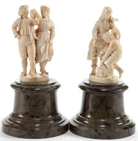 86003: A PAIR OF CONTINENTAL CARVED IVORY FIGURAL GROUP