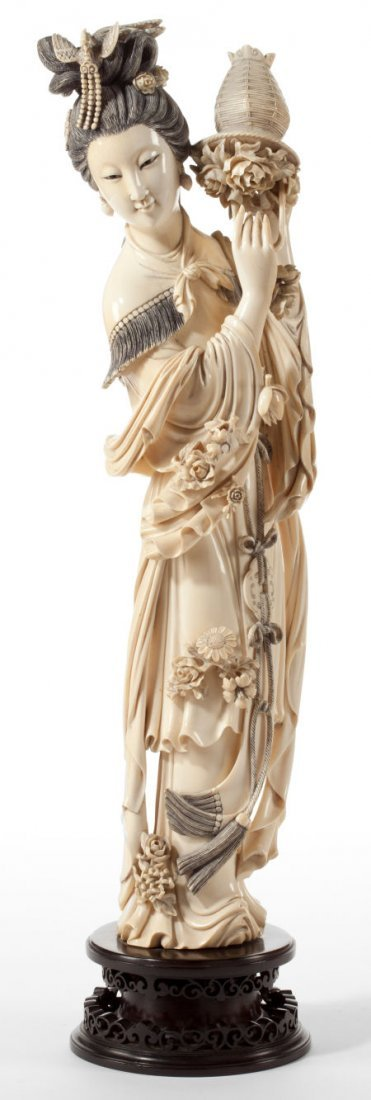 86176: A CHINESE CARVED IVORY FIGURE  OF GUANYIN  Circa