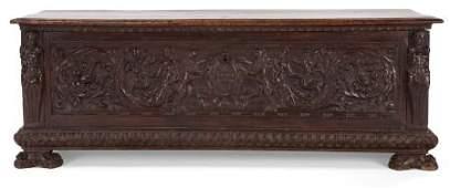 87118 AN ITALIAN CARVED WALNUT CASSONE  19th century
