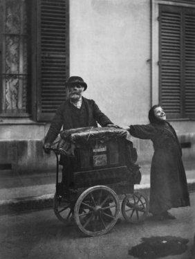 EUG�NE ATGET (French, 1857-1927) Organ Grinder A