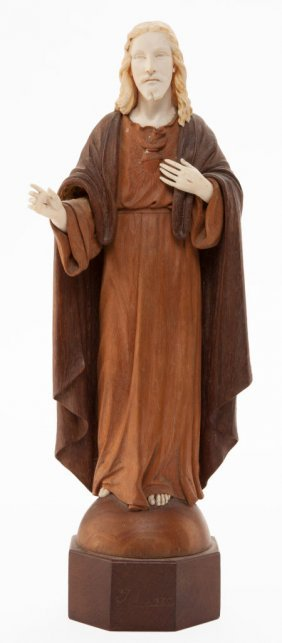 66006: A CONTINENTAL IVORY AND WOOD CARVED FIGURE OF CH