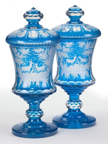 66009: A PAIR OF BOHEMIAN BLUE FLASHED GLASS COVERED UR