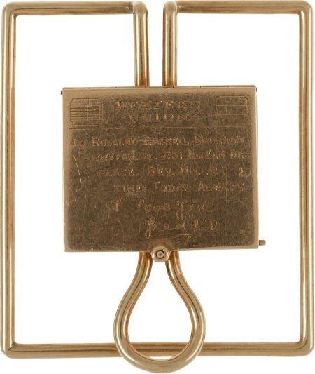 46016: A Rosalind Russell 14K Gold Money Clip / Locket,