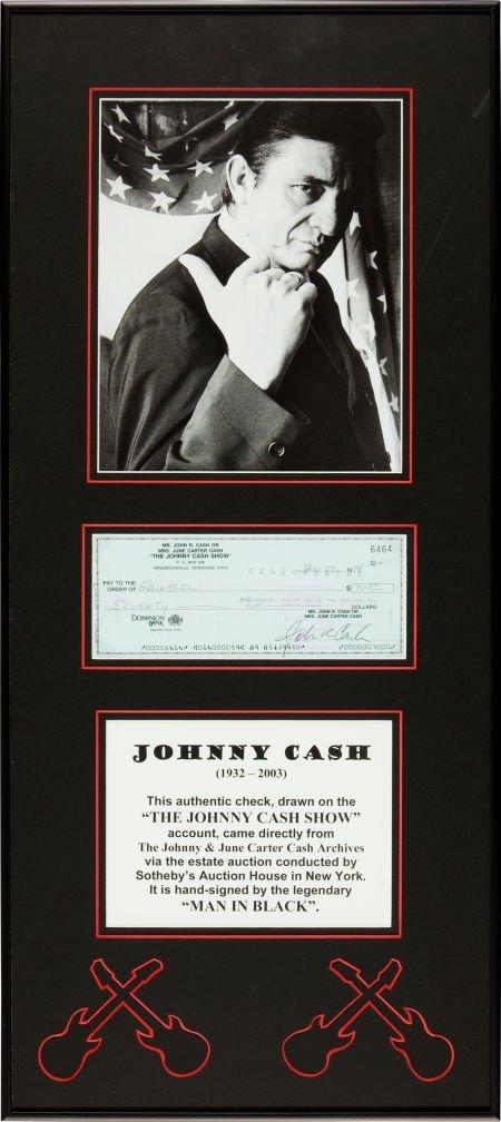 46436: Johnny Cash Signed Check.