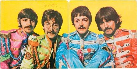 46166: Beatles John Lennon Signed Sgt. Peppers Lonely H