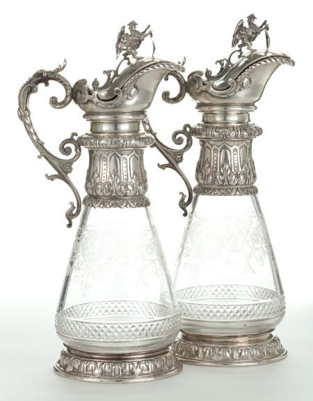 89216: A PAIR OF AUSTRIAN GLASS AND SILVER WINE EWERS