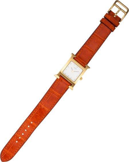 56006: Hermes Gold H-Hour PM Watch with Orange H Alliga