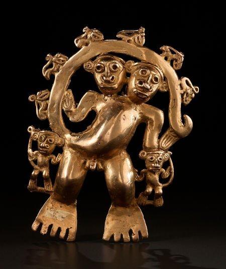 54277: A LARGE QUIMBAYA GOLD PENDANT REPRESENTING A COM