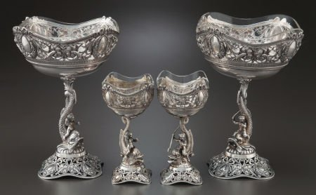 68020: A SET OF FOUR GERMAN SILVER COMPOTES WITH SHAPED