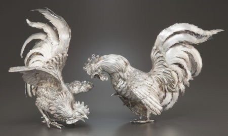 68023: A PAIR OF GERMAN SILVER ROOSTERS Maker unknown,