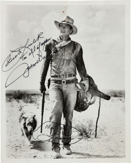 46022: A John Wayne Signed Black and White Photograph,