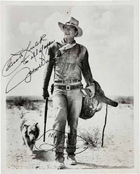46022: A John Wayne Signed Black and White Photograph,