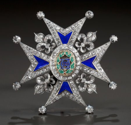62679: A SILVERED GOLD, DIAMOND AND ENAMEL COMMANDER'S