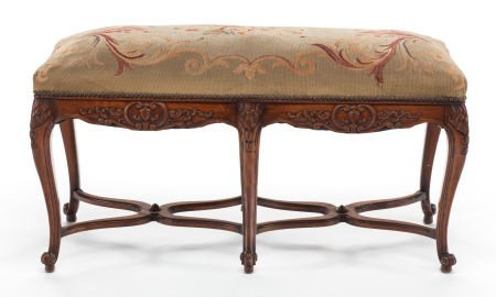 63388: A FRENCH PROVINCIAL CARVED WALNUT BENCH WITH AUB