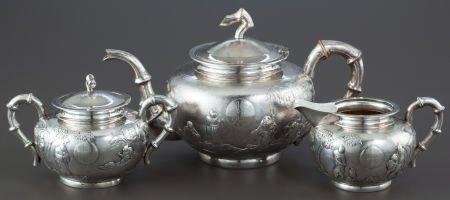 68013: A THREE PIECE GUANG JI CHINESE EXPORT SILVER TEA