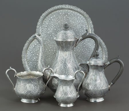 68015: A FIVE PIECE INDIAN SILVER COFFEE SERVICE AND TR