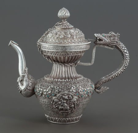 68018: A TIBETAN SILVER AND HARDSTONE COVERED EWER  Cir