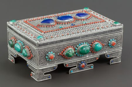 68020: A NEPALESE SILVER FILIGREE AND HARDSTONE MOUNTED